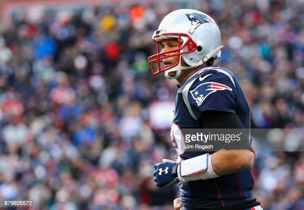 Tom Brady of the New England Patriots reacts during the first quarter of a game against the Miami Dolphins at Gillette Stadium on November 26 2017 in...