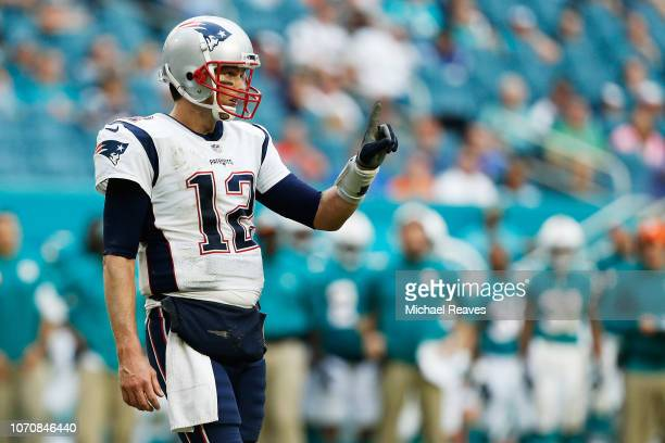 Tom Brady of the New England Patriots reacts during the second half against the Miami Dolphins at Hard Rock Stadium on December 9 2018 in Miami...