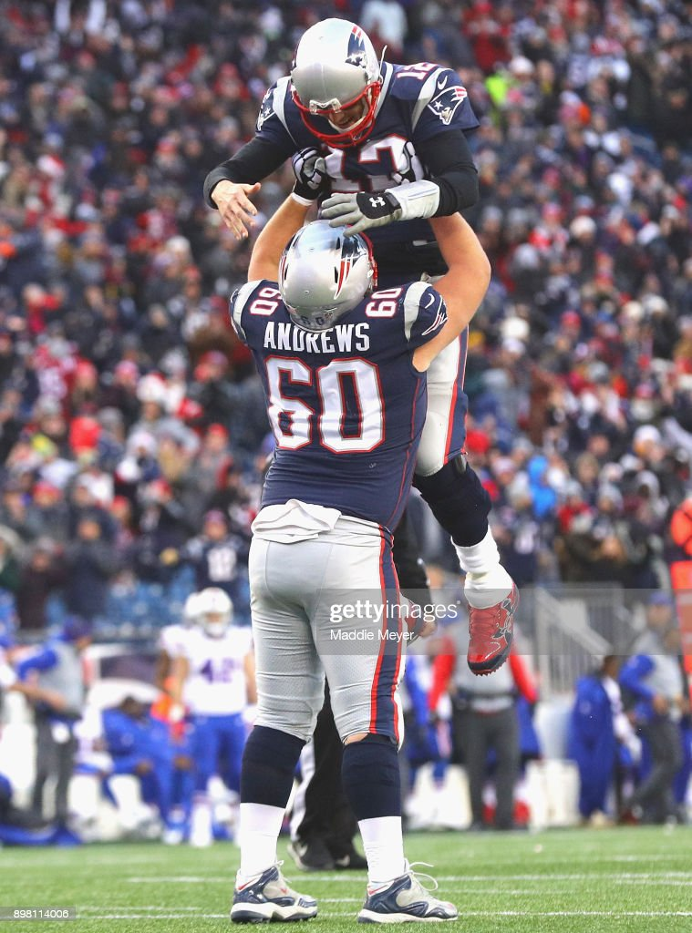 Tom Brady #12 of the New England Patriots reacts with David Andrews #60 during the fourth quarter of a game against the Buffalo Bills at Gillette Stadium on December 24, 2017 in Foxboro, Massachusetts.
