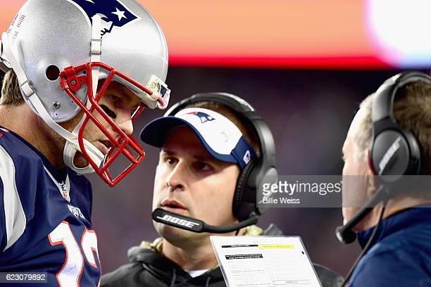 Tom Brady of the New England Patriots reacts with head coach Bill Belichick and offensive coordinator Josh McDaniels during the fourth quarter of a...
