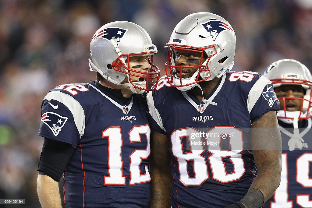 Tom Brady #12 of the New England Patriots reacts with Martellus Bennett #88 after scoring a touchdown during the third quarter against the Baltimore Ravens at Gillette Stadium on December 12, 2016 in Foxboro, Massachusetts.