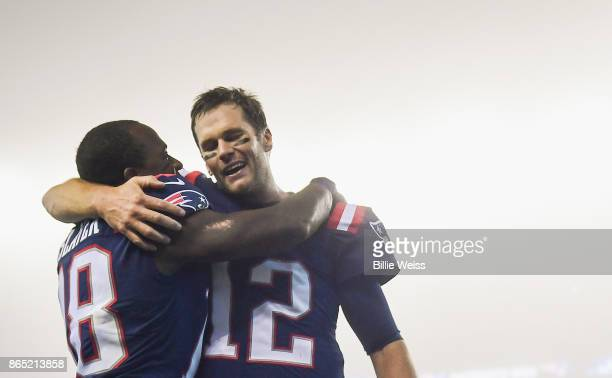 Tom Brady of the New England Patriots reacts with Matthew Slater after a game against the Atlanta Falcons at Gillette Stadium on October 22 2017 in...