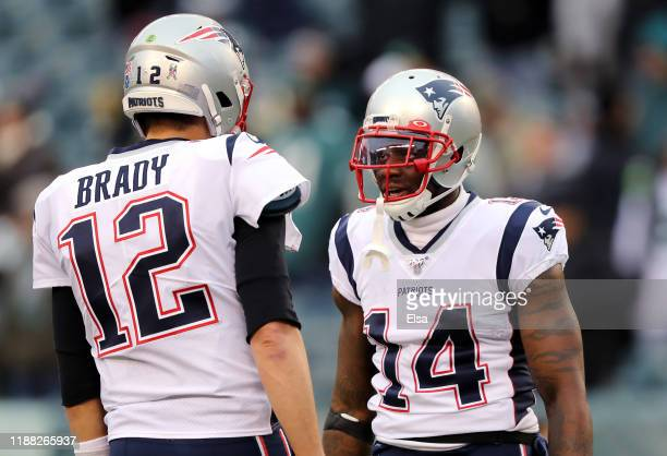 Tom Brady of the New England Patriots reacts with Mohamed Sanu before the game against the Philadelphia Eagles at Lincoln Financial Field on November...