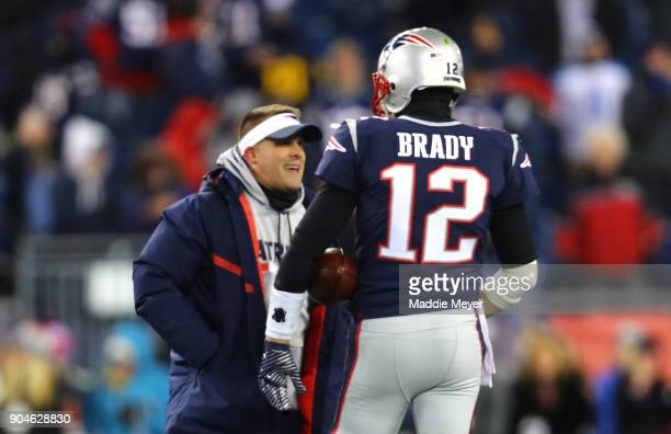 Tom Brady of the New England Patriots reacts with Offensive Coordinator Josh McDaniels before the AFC Divisional Playoff game against the Tennessee...