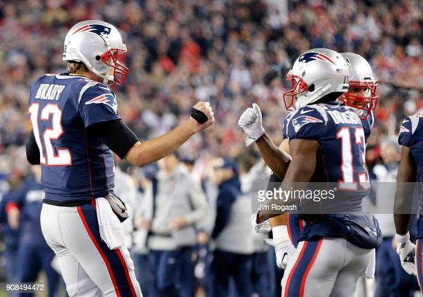 Tom Brady of the New England Patriots reacts with Phillip Dorsett in the second half during the AFC Championship Game against the Jacksonville...