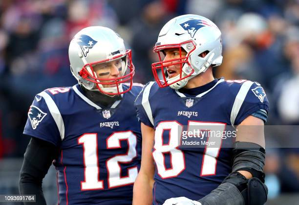 Tom Brady of the New England Patriots reacts with Rob Gronkowski during the third quarter in the AFC Divisional Playoff Game against the Los Angeles...