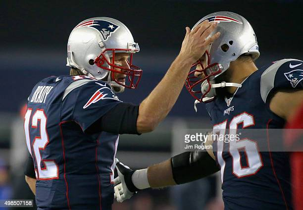 Tom Brady of the New England Patriots reacts with Sebastian Vollmer before a game against the Buffalo Bills at Gillette Stadium on November 23 2015...