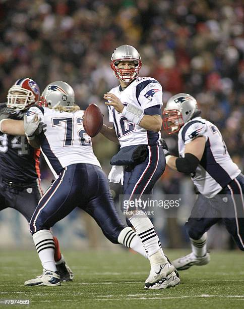 Tom Brady of the New England Patriots readies to pass against the Buffalo Bills at Ralph Wilson Stadium November 18, 2007 in Orchard Park, New York....