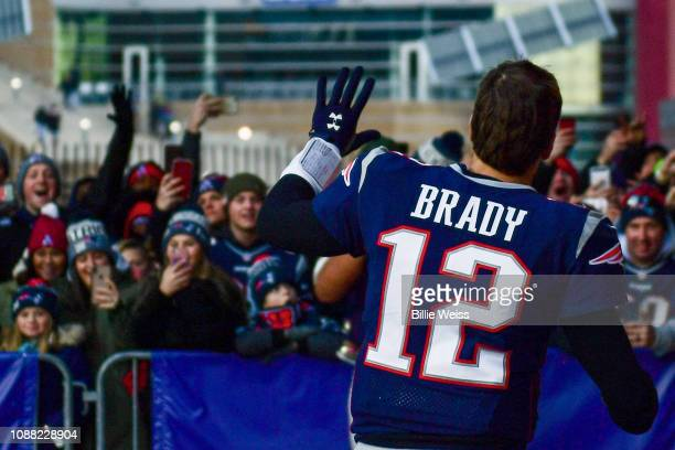 Tom Brady of the New England Patriots runs off the field after a game against the New York Jets at Gillette Stadium on December 30 2018 in Foxborough...
