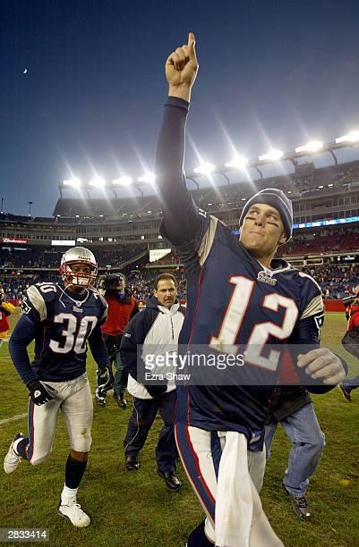 Tom Brady of the New England Patriots runs off the field after they beat the Buffalo Bills 310 on December 27 2003 at Gillette Stadium in Foxboro...
