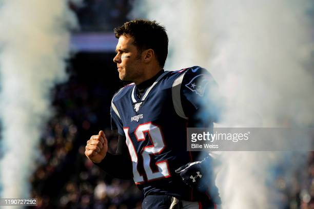 Tom Brady of the New England Patriots runs onto the field before a game against the Miami Dolphins at Gillette Stadium on December 29, 2019 in...