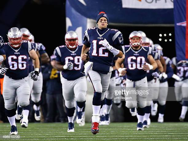 Tom Brady of the New England Patriots runs onto the field before a game against the Buffalo Bills at Gillette Stadium on November 23 2015 in Foxboro...