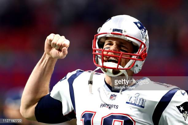 Tom Brady of the New England Patriots runs out on to the field prior to Super Bowl LIII against the Los Angeles Rams at MercedesBenz Stadium on...