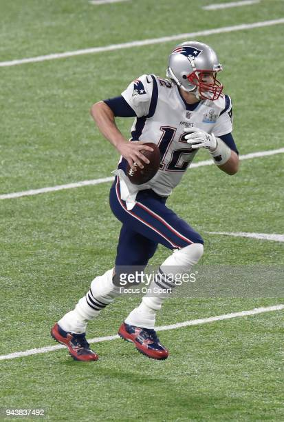 Tom Brady of the New England Patriots runs with the ball against the Philadelphia Eagles during Super Bowl LII at US Bank Stadium on February 4 2018...