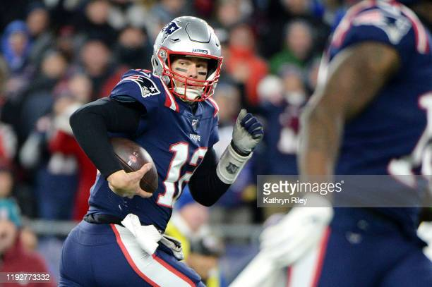 Tom Brady of the New England Patriots runs with the ball during the second half against the Kansas City Chiefs in the game at Gillette Stadium on...