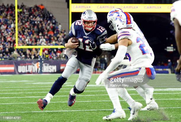 Tom Brady of the New England Patriots runs with the ball during the second half against the Buffalo Bills in the game at Gillette Stadium on December...