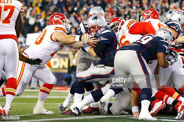 Tom Brady of the New England Patriots scores a touchdown in the second quarter against the Kansas City Chiefs during the AFC Divisional Playoff Game...