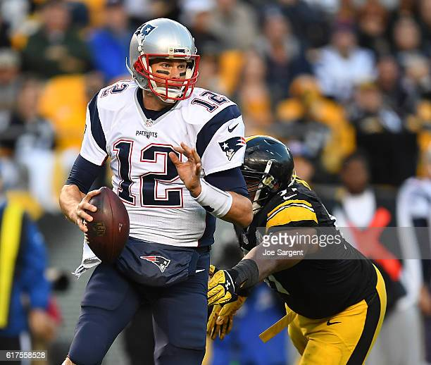 Tom Brady of the New England Patriots scrambles away from Stephon Tuitt of the Pittsburgh Steelers in the second half during the game against the...