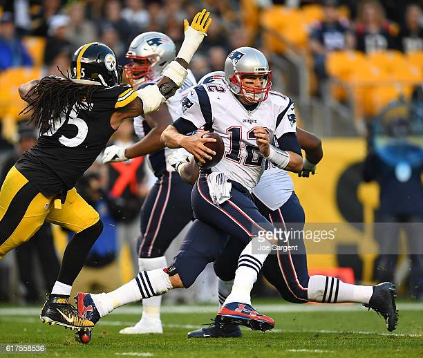 Tom Brady of the New England Patriots scrambles to avoid the rush of Jarvis Jones of the Pittsburgh Steelers in the second half during the game at...