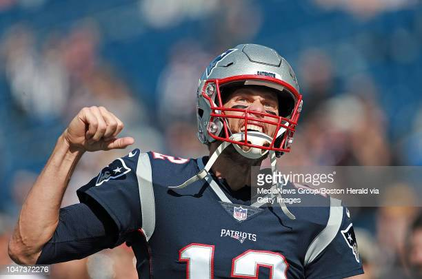 Tom Brady of the New England Patriots screams out and pumps his fist before the NFL game against the Miami Dolphins at Gillette Stadium on September...