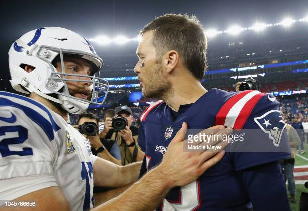 Tom Brady of the New England Patriots shakes hands with Andrew Luck of the Indianapolis Colts after the Patriots defeated the Colts 3824 at Gillette...