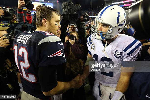 Tom Brady of the New England Patriots shakes hands with Andrew Luck of the Indianapolis Colts after their AFC Divisional Playoff game at Gillette...