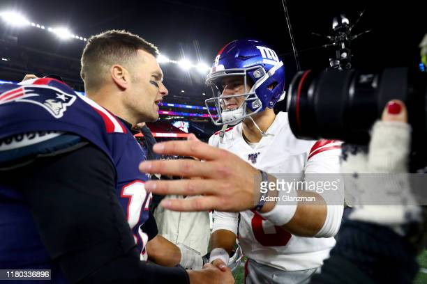 Tom Brady of the New England Patriots shakes hands with Daniel Jones of the New York Giants after their game at Gillette Stadium on October 10, 2019...