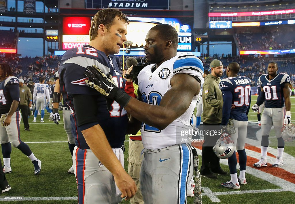 Tom Brady #12 of the New England Patriots shakes hands with James Ihedigbo #32 of the Detroit Lions after a game at Gillette Stadium on November 23, 2014 in Foxboro, Massachusetts.