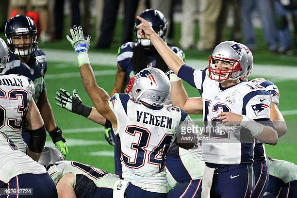 Tom Brady of the New England Patriots signals for a first down after a penalty by the Seattle Seahawks late in the game during Super Bowl XLIX at...