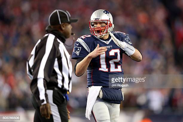 Tom Brady of the New England Patriots signals for a timeout in the first half against the Kansas City Chiefs during the AFC Divisional Playoff Game...