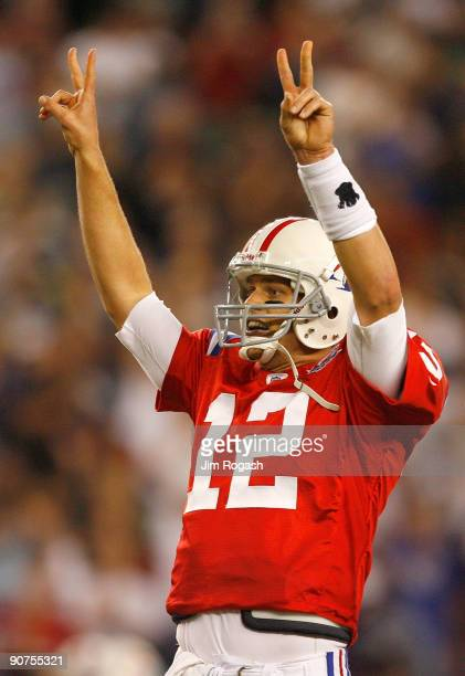 Tom Brady of the New England Patriots signals that he will attempt a two-point conversion after touchdown in the fourth quarter against the Buffalo...