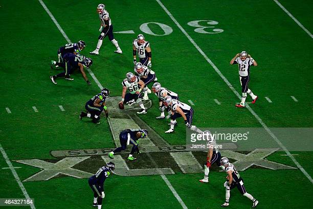 Tom Brady of the New England Patriots signals to his line in the fourth quarter against the Seattle Seahawks during Super Bowl XLIX at University of...