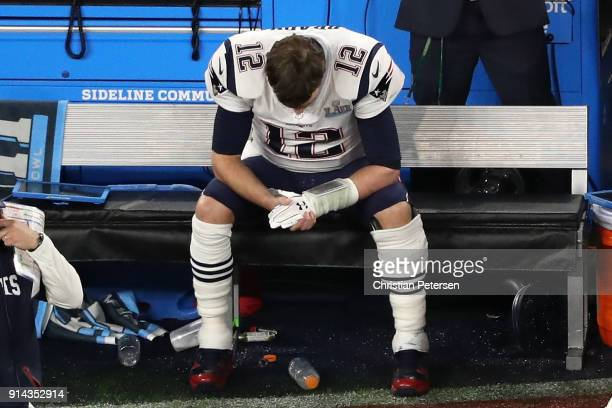 Tom Brady of the New England Patriots sits on the bench after having the ball stripped by Brandon Graham of the Philadelphia Eagles late in the...
