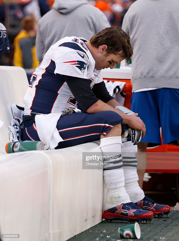 Tom Brady #12 of the New England Patriots sits on the bench late in the fourth quarter against the Denver Broncos in the AFC Championship game at Sports Authority Field at Mile High on January 24, 2016 in Denver, Colorado.