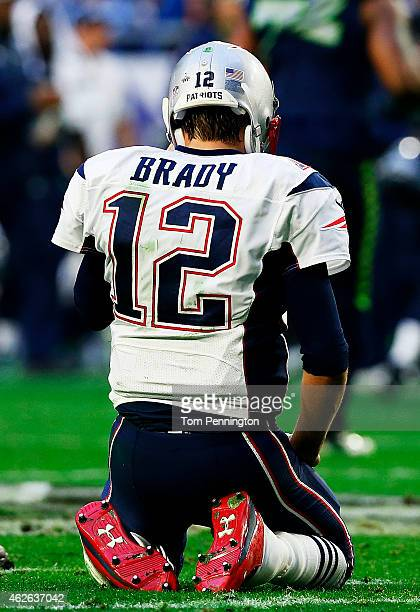 Tom Brady of the New England Patriots sits on the field after throwing an interception against the Seattle Seahawks in the first quarter during Super...