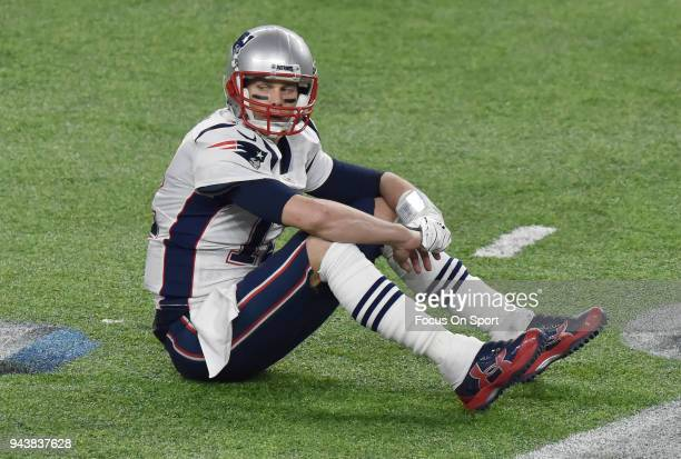 Tom Brady of the New England Patriots sits on the field an looks on after a play against the Philadelphia Eagles during Super Bowl LII at US Bank...