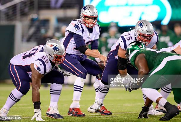 Tom Brady of the New England Patriots snaps the ball against the New York Jets at MetLife Stadium on October 21 2019 in East Rutherford New Jersey