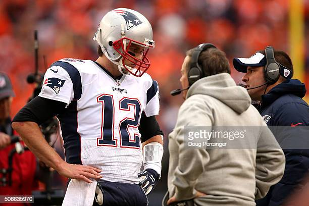 Tom Brady of the New England Patriots speaks to head coach Bill Belichick in the fourth quarter against the Denver Broncos in the AFC Championship...