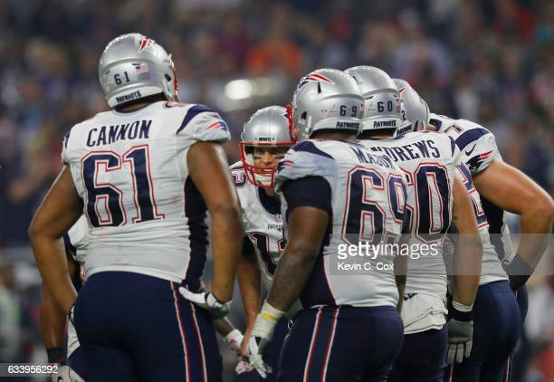 Tom Brady of the New England Patriots speaks to his team in the huddle in the fourth quarter against the Atlanta Falcons during Super Bowl 51 at NRG...