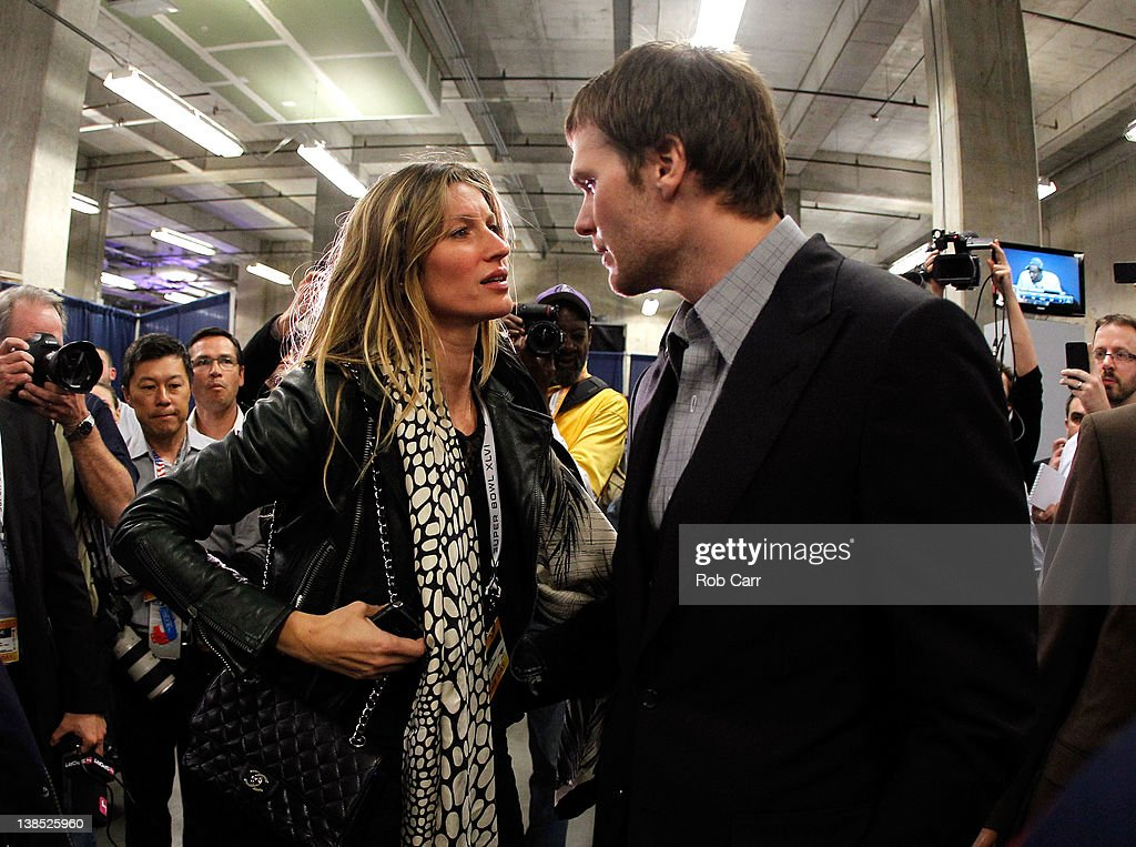 Tom Brady #12 of the New England Patriots speaks to his wife Gisele Bundchen after losing to the New York Giants by a score of 21-17 in Super Bowl XLVI at Lucas Oil Stadium on February 5, 2012 in Indianapolis, Indiana.