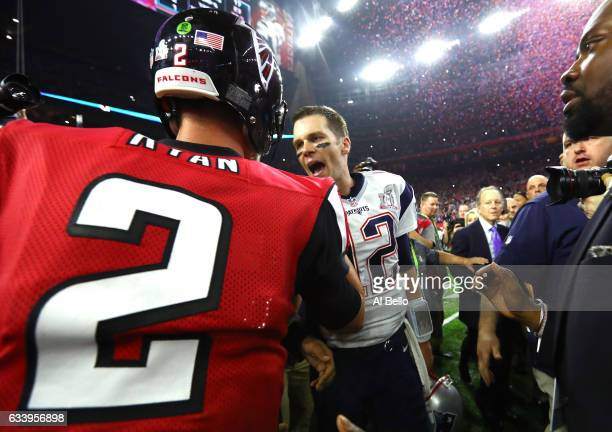 Tom Brady of the New England Patriots speaks to Matt Ryan of the Atlanta Falcons after winning Super Bowl 51 at NRG Stadium on February 5 2017 in...