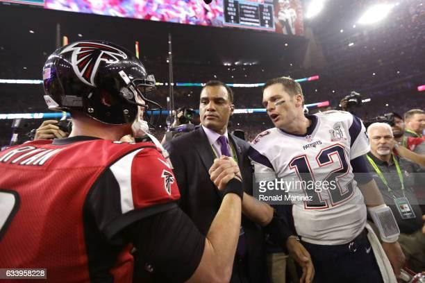 Tom Brady of the New England Patriots speaks to Matt Ryan of the Atlanta Falcons after winning Super Bowl 51 at NRG Stadium on February 5 2017 in...