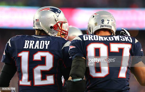 Tom Brady of the New England Patriots speaks to Rob Gronkowski after a first quarter touchdown against the Kansas City Chiefs during the AFC...