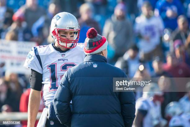 Tom Brady of the New England Patriots speaks with head coach Bill Belichick before the game against the Buffalo Bills at New Era Field on December 3...