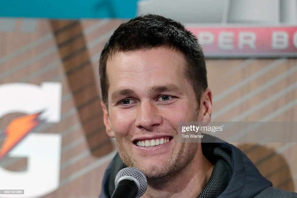 Tom Brady #12 of the New England Patriots speaks with the media during Super Bowl 51 Opening Night at Minute Maid Park on January 30, 2017 in Houston, Texas.
