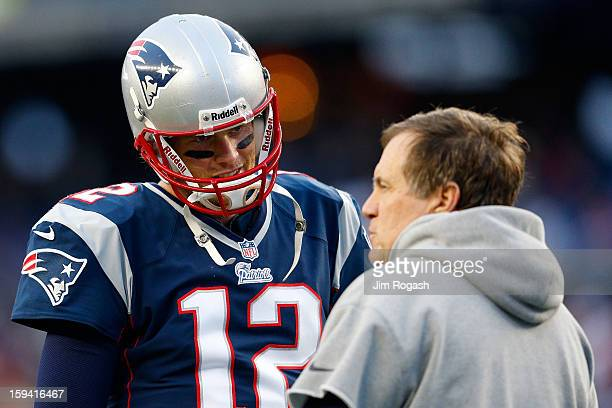 Tom Brady of the New England Patriots stands on the field with head coach Bill Belichick of the New England Patriots prior to playing against the...
