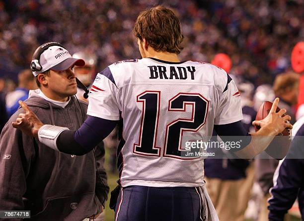 Tom Brady of the New England Patriots talks on the sidelines against the New York Giants on December 29 2007 at Giants Stadium in East Rutherford New...