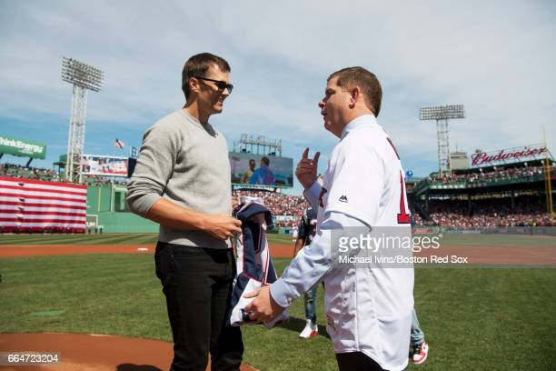Tom Brady of the New England Patriots talks to Boston mayor Marty Walsh during a ceremony honoring the Super Bowl champions at Fenway Park before an...