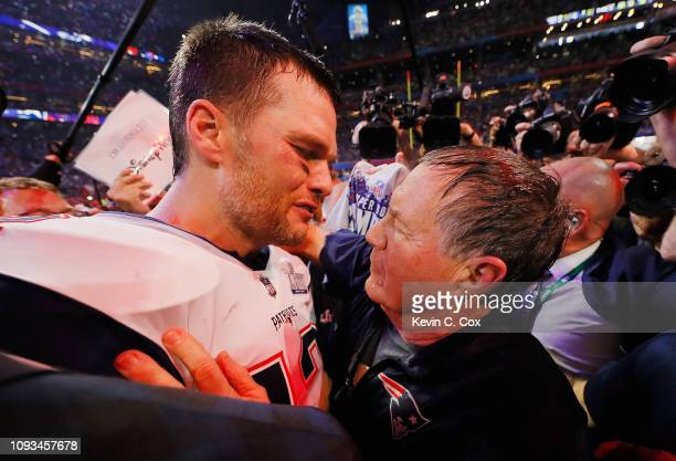 Tom Brady of the New England Patriots talks to head coach Bill Belichick of the New England Patriots after the Patriots defeat the Rams 133 during...