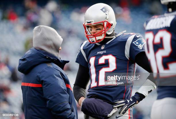 Tom Brady of the New England Patriots talks to head coach Bill Belichick before the game against the New York Jets at Gillette Stadium on December 31...